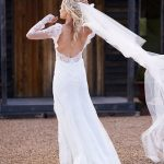 long-sleeved Maggie Sottero gown classic sheath wedding dress