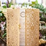 Elaborate, laser cut gold gate fold invitation