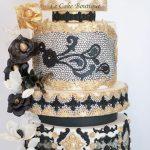 Gold and black wedding cake theme