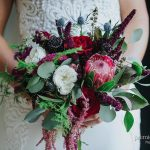 Deep red tones in bridal bouquet