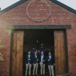Groom and Groomsmen outside rustic building