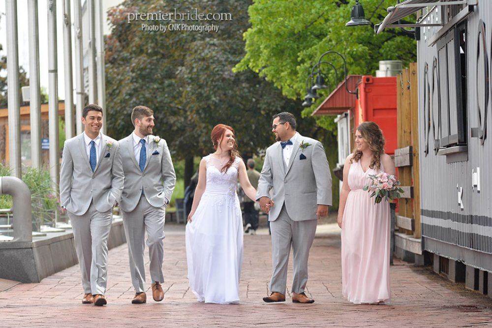 Bridal party walking down the shores of Philadelphia