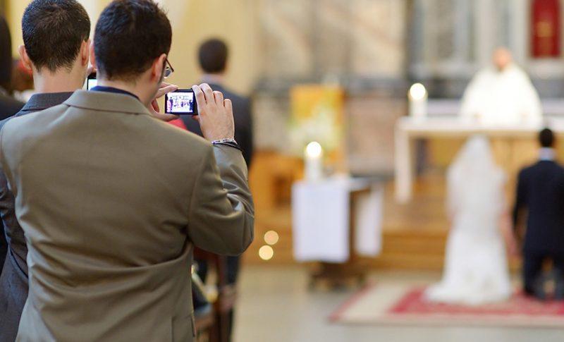 man taking photo at wedding ceremony